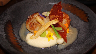 A plate of scallops served at 16 - A Handmade Experience at The M Resort Spa Casino in Las Vegas, Nevada.