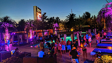 Guests at DayDream Pool Club at The M Resort party during a nighttime event.