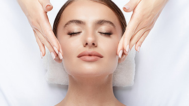 Woman at spa getting a face massage