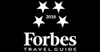 2018 Forbes Travel Guide four-star logo in white on a black background.