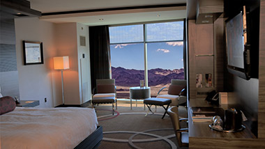View of the mountains and king bed inside the Executive Resort Room.