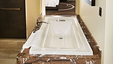 The bathtub inside the M Resort, Executive and M Experience rooms.