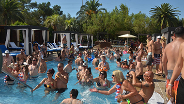 Guests at DayDream Pool Club at the M Resort dive into the pool near Las Vegas.